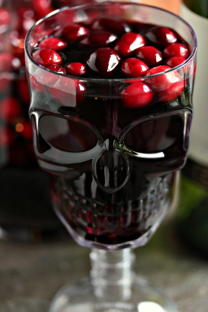 Cranberry sangria served in a skull glass for Halloween.