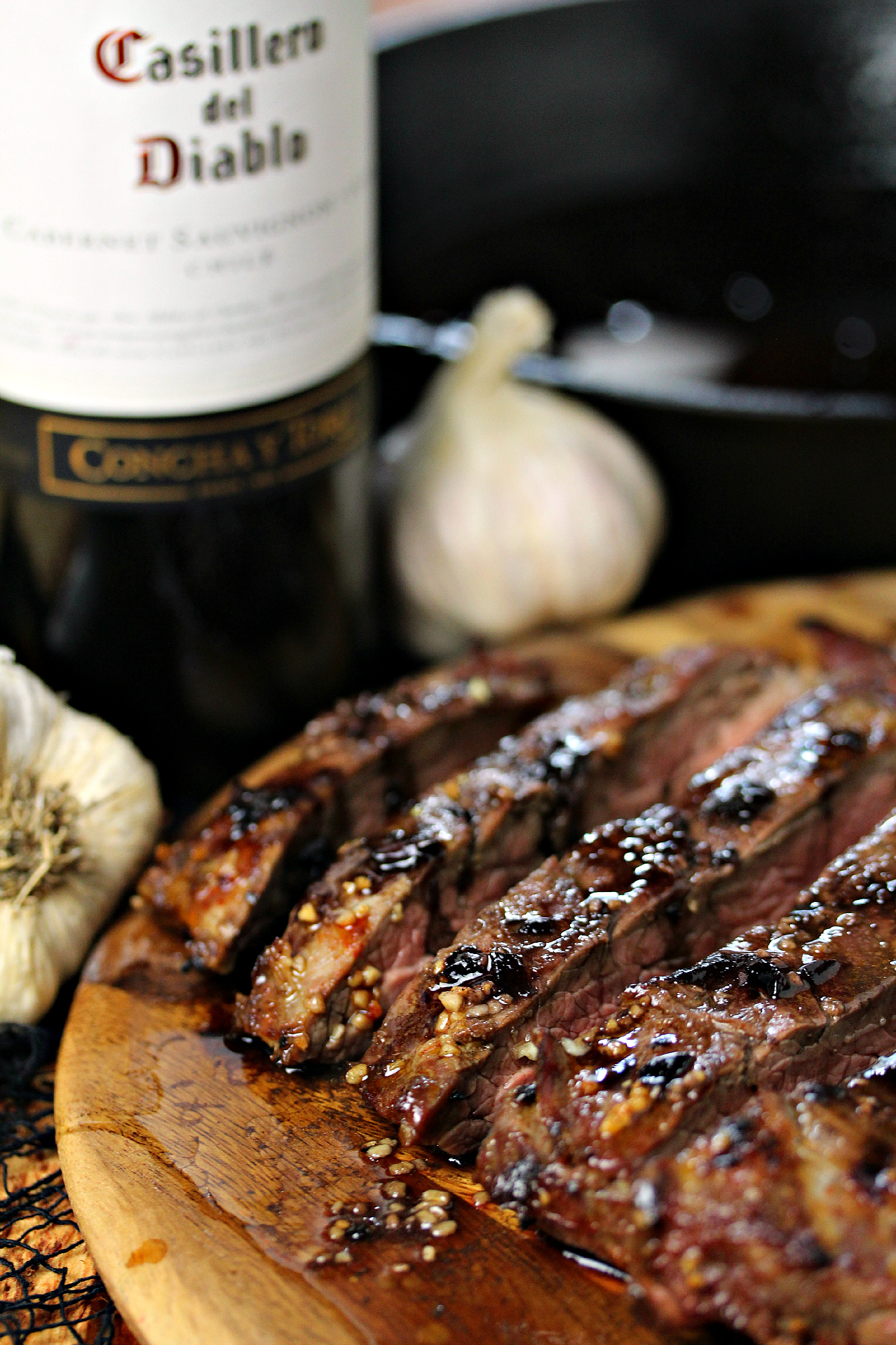 Vampire Steaks with Garlic Red Wine Reduction for Casillero del Diablo Wines- This recipe uses flank steak marinated in garlic then grilled to perfection. It's topped with a red wine reduction made with garlic and onions. This is perfection for Halloween, or any time of the year.