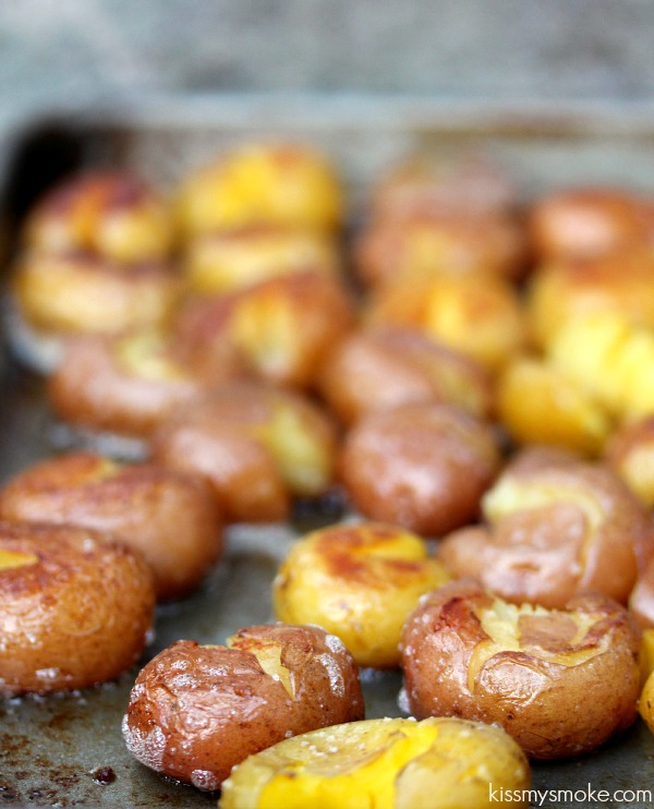 Grilled Smashed Potatoes from kissmysmoke.com- Ruby and Golden Mini Potatoes cooked in chicken broth, then smashed and cooked on the grill with butter, and coarse salt. Absolutely delicious and addictive side dish. Simple recipe anyone of any skill level can make. (@CravingsLunatic)
