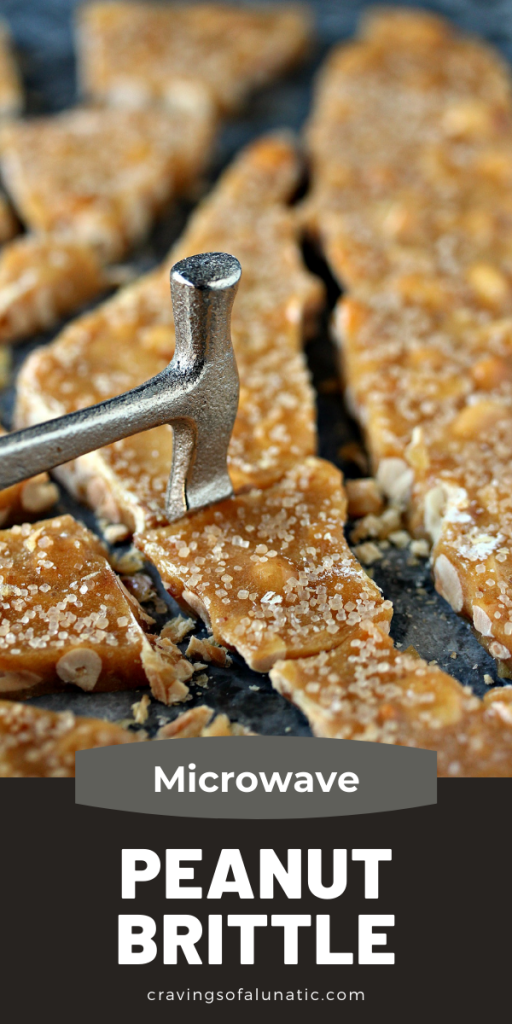 Microwave Peanut Brittle being broken with a tiny toffee hammer.
