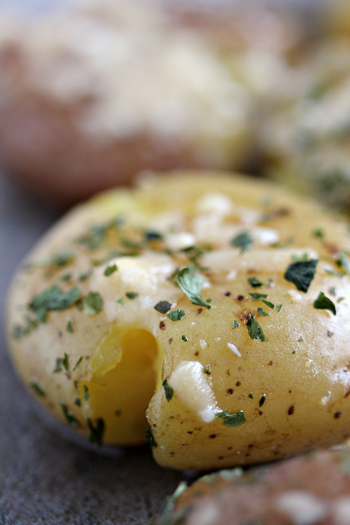 Parmesan Smashed Potatoes served with extra cheese and parsley.