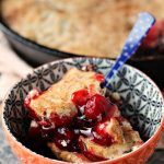 This cherry cobbler recipe is easy, quick and utterly delicious. It's topped with chocolate chip muffin mix for everyone who loves cherries with chocolate as much as I do! #cherry #cobbler