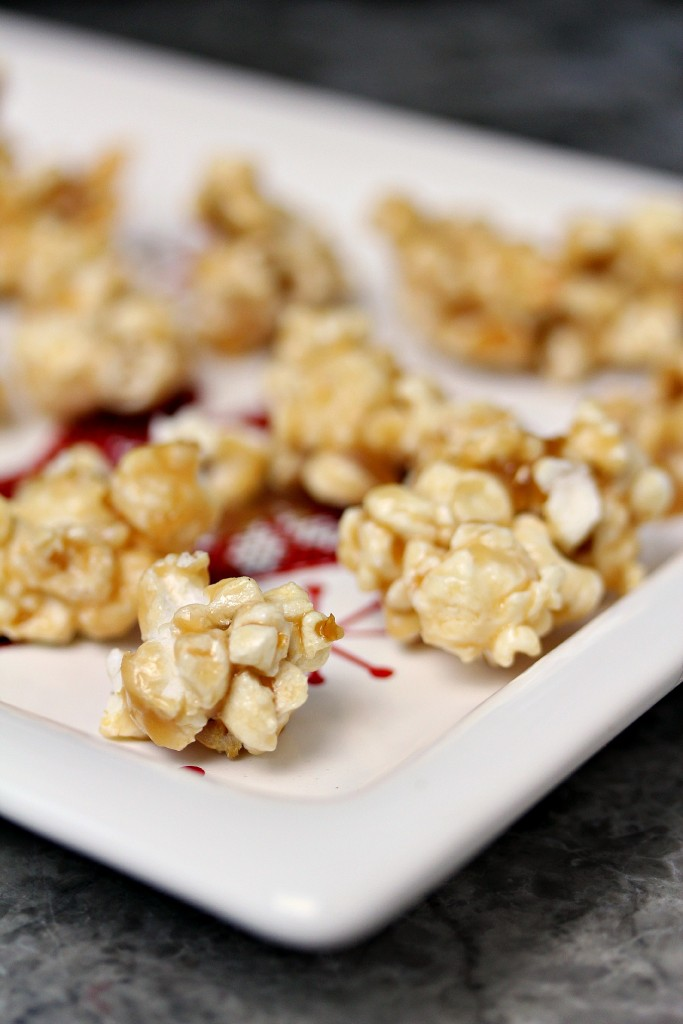 root beer popcorn on a white plate.