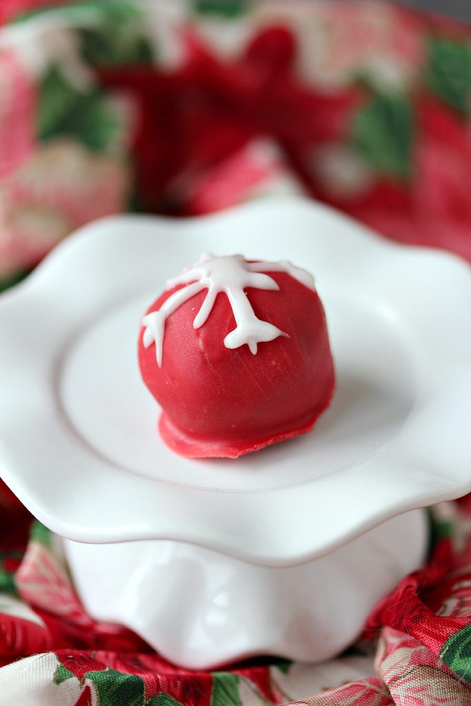 Snowflake OREO Cookie Balls from cravingsofalunatic.com- This recipe is perfect for the holiday season. OREO Cookies are mixed with cream cheese, then coated with chocolate, or red candy coating, then decorated with tiny snowflakes. (@CravingsLunatic)