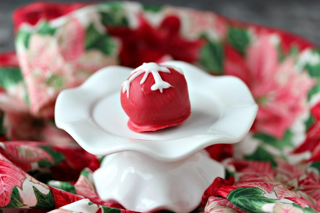 Snowflake OREO Cookie Balls served on a white mini cake stand.
