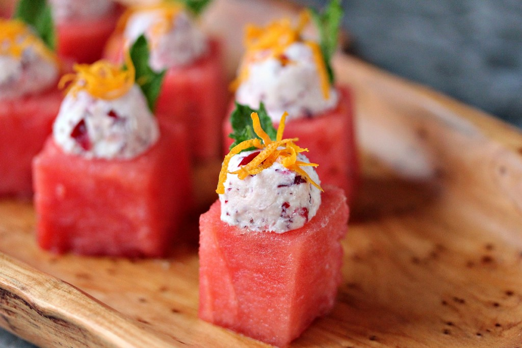 Watermelon Cups with Cranberry Mascarpone served on a wood tray.