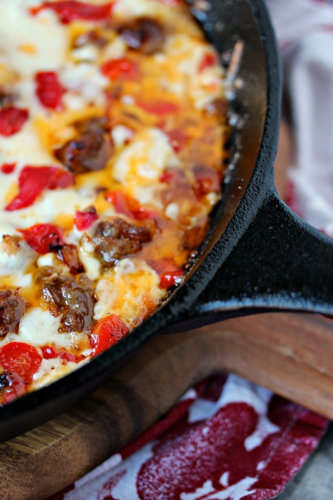 Fundido Dip from cravingsofalunatic.com- Homemade Fundido made with caramelized onions, roasted red peppers, ground sausage and a 4 cheese blend! This recipe is a sausage lovers dream come true! (@CravingsLunatic)