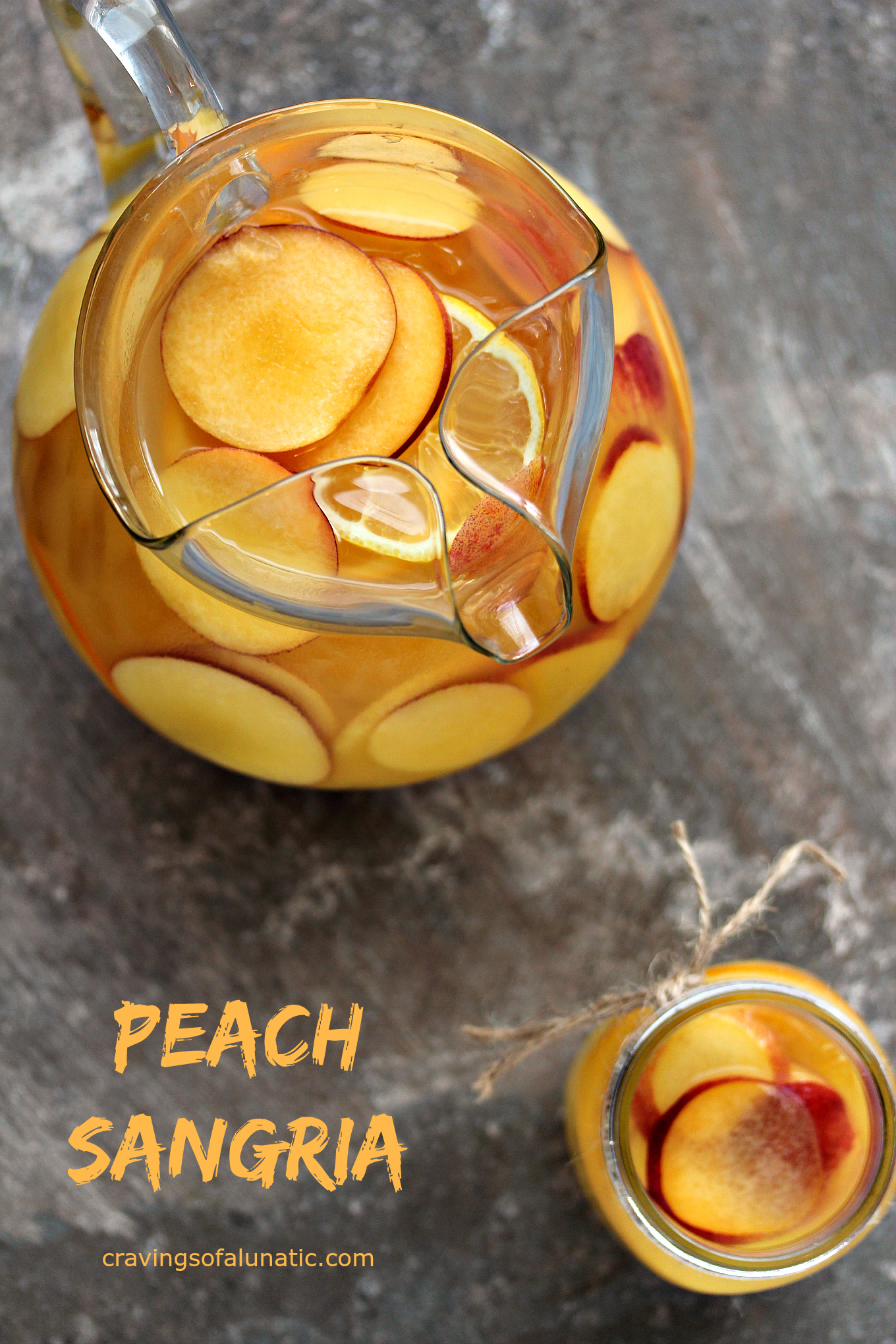 Peach Sangria from cravingsofalunatic.com. This easy recipe for Peach Sangria is sure to be a hit with your family and friends. Celebrate in style with this tasty mix of peach, orange, lemon and Sauvignon Blanc. #peach #sangria #cocktai
