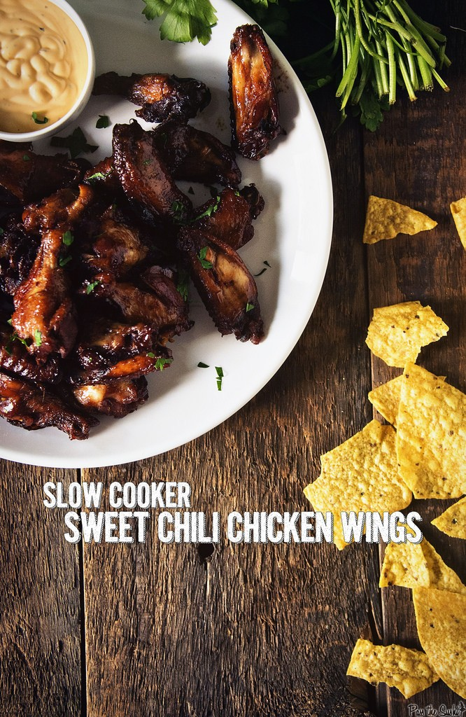 Slow Cooker Sweet Chili Chicken Wings from Girl Carnivore, featured on cravingsofalunatic.com for our weekly meal plan, week 29. Swing by the blog every Saturday for more great meal plans. (@CravingsLunatic)