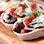 This recipe for steak bites mini taco boats uses beef marinated in beer, which is cooked to perfection in a cast iron skillet, then topped with barbecue sauce. Every bite is full of flavour.
