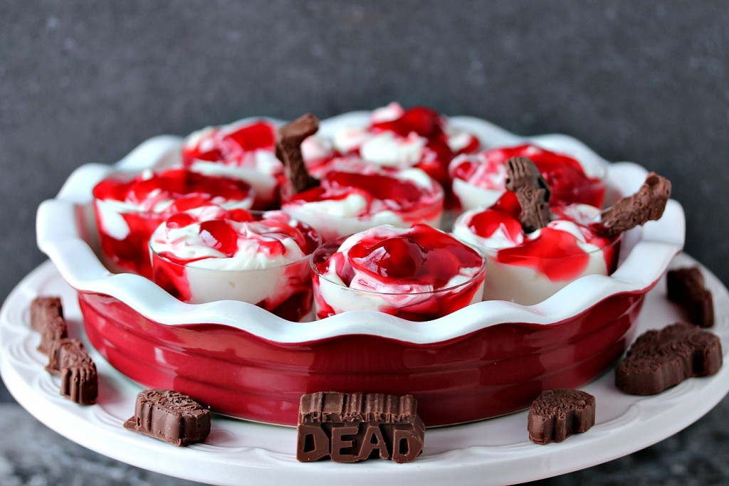 cherry dip served in tiny glass dishes on a white cake stand