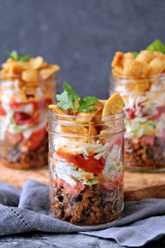 Mini FRITOS Taco Salads from cravingsofalunatic.com- These Mini FRITOS Taco Salads are the perfect dish to whip up for potlucks or picnics. They are incredibly easy to make and can customize them to your own taste. (@CravingsLunatic)