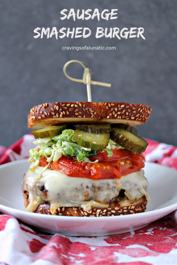 Sausage Smashed Burger from cravingsofalunatic.com- This Sausage Smashed Burger Recipe is packed with flavour. Jarlsberg cheese, homemade pickles, and homemade sprout slaw are piled high for the ultimate burger experience!