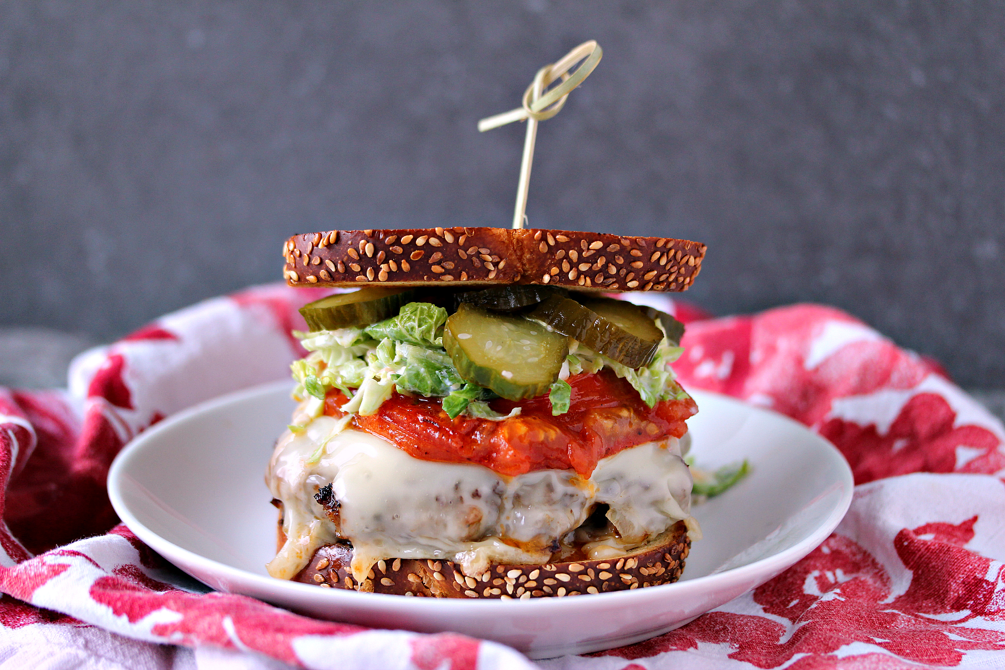 Sausage Smashed Burger Recipe that is packed with flavour and topped with Jarlsberg cheese, homemade pickles, and homemade sprout slaw.