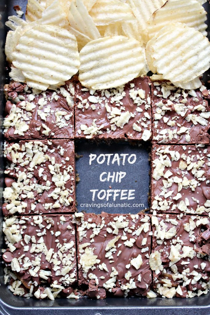 overhead image of Potato Chip Toffee made with lots of chocolate and crushed chips and some whole chips on the plate nearby