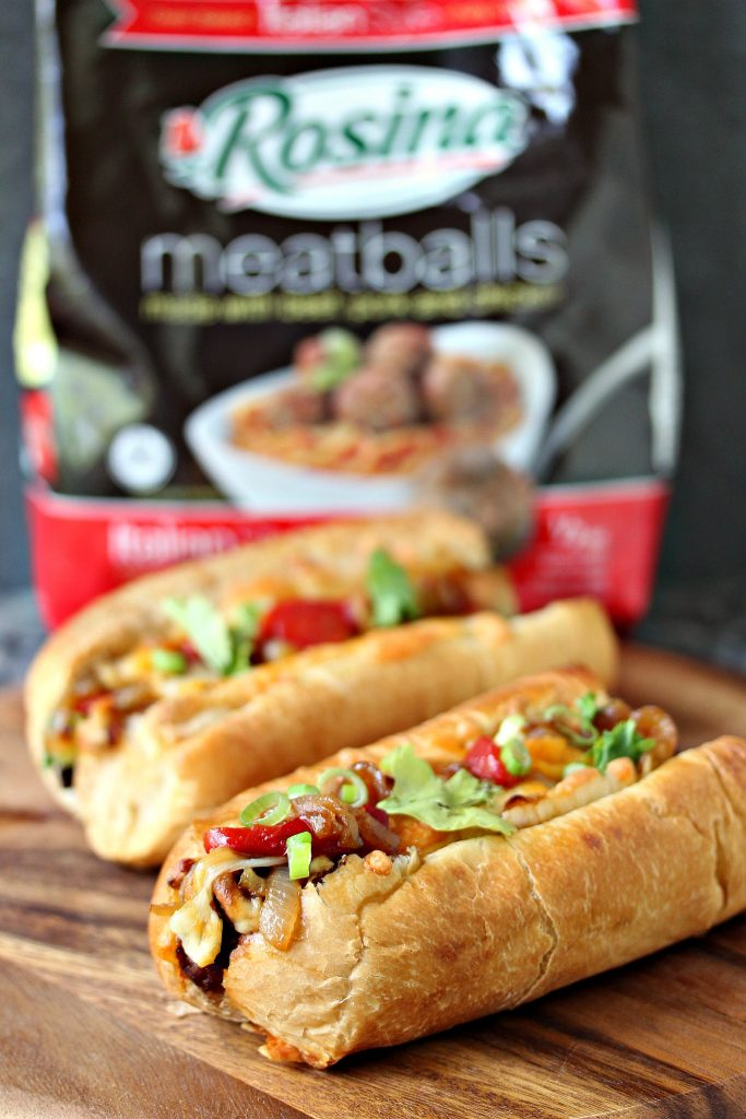 Tex-Mex Meatball Subs from cravingsofalunatic.com- Meatballs smothered in enchilada sauce, topped with roasted red peppers and caramelized onions, then topped with a Mexican 4 Cheese Blend. All packed into mini sub buns. (@CravingsLunatic)