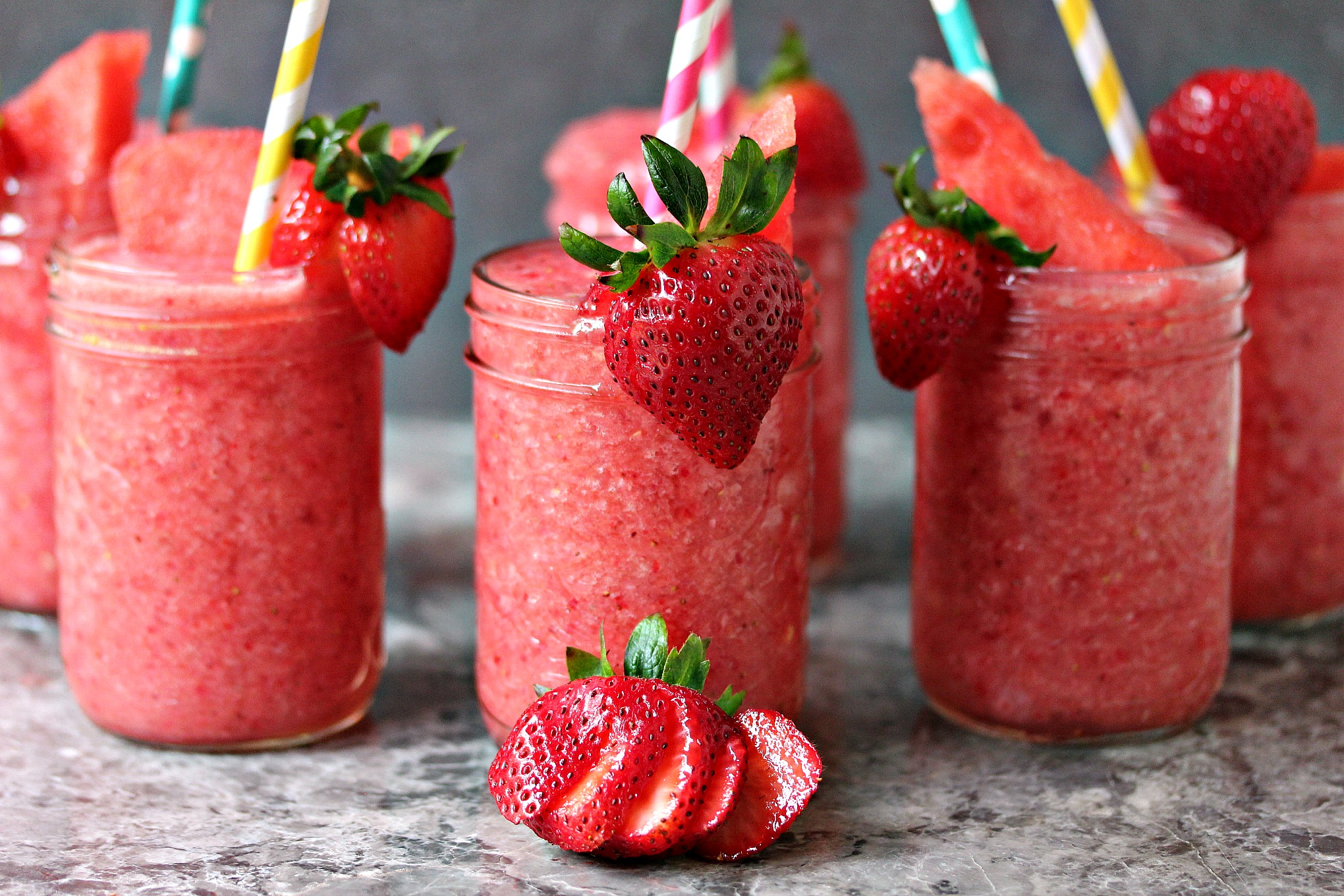 Boozy Strawberry Watermelon Slushies from cravingsofalunatic.com- These gorgeous Boozy Strawberry Watermelon Slushies are a delicious way to beat the heat. Quench your thirst in style this summer! (@CravingsLunatic)