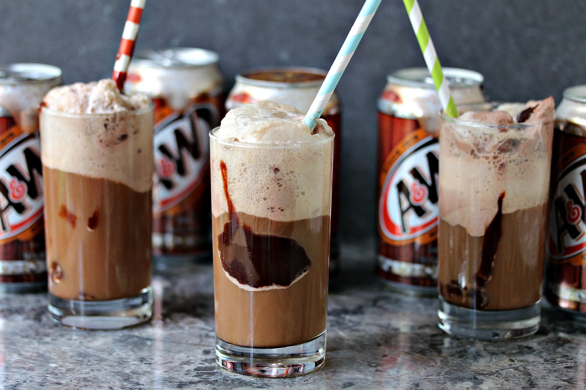 Chocolate Hot Fudge Root Beer Float from cravingsofalunatic.com- Chocolate Ice Cream, Hot Fudge Sauce and A&W® Root Beer combine for the ultimate Root Beer Float. This is incredibly easy to make, and utterly impossible to resist. (@CravingsLunatic)
