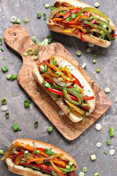Grilled Fajita Hot Dogs from cravingsofalunatic.com- Grilled Hot Dogs topped with grilled bell peppers and onions. This recipe is incredibly easy to make, yet bursting with flavour. Be a legend at your grill this summer! (@CravingsLunatic)
