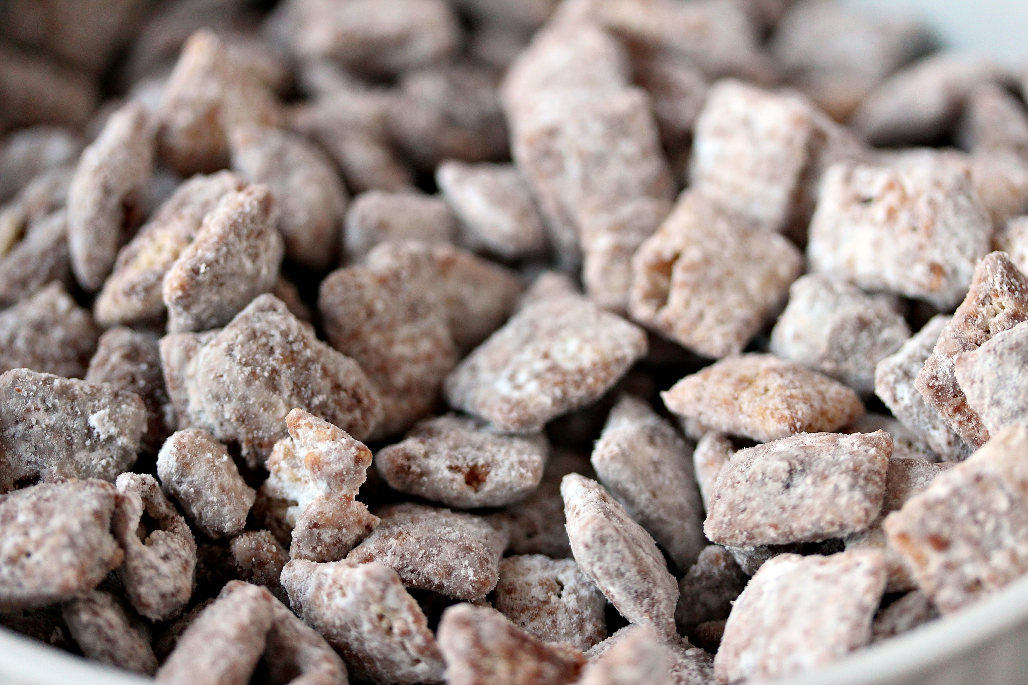 "Nutella Muddy Buddies aka Nutella Puppy Chow from cravingsofalunatic.com- Nutella muddy buddies, a.k.a Nutella ""puppy chow"", is sure to be a hit with kids and adults alike. Make a double batch because this stuff is addictive! (@CravingsLunatic)"
