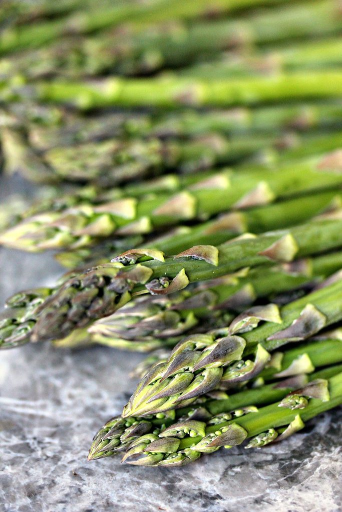 Raw Asparagus! Use this for Roasted Asparagus with Lemon, Garlic, and Shallot Butter from cravingsofalunatic.com- Oven roasted asparagus cooked to perfection, then topped with a simple lemon, garlic and shallot butter. Simply delicious and perfect for any night of the week! (@CravingsLunatic)