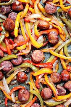 Sheet Pan Sausage and Peppers from cravingsofalunatic.com- This recipe is simple to make yet full of flavour. It's perfect to eat on its own, or pile it high on a hoagie bun. One pan, a few simple ingredients, and you have the perfect lunch or dinner recipe. (@CravingsLunatic)