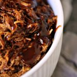 Slow Cooker Pulled BBQ Chicken in a white bowl.