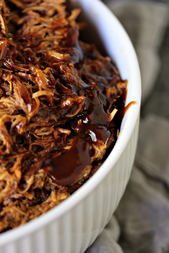 "Slow Cooker Pulled BBQ Chicken from cravingsofalunatic.com- This easy recipe for pulled BBQ chicken is made in the slow cooker with just a few ingredients. It's a great ""set it and forget it"" recipe. Eat it plain, or pile it high on a slider bun! (@CravingsLunatic)"