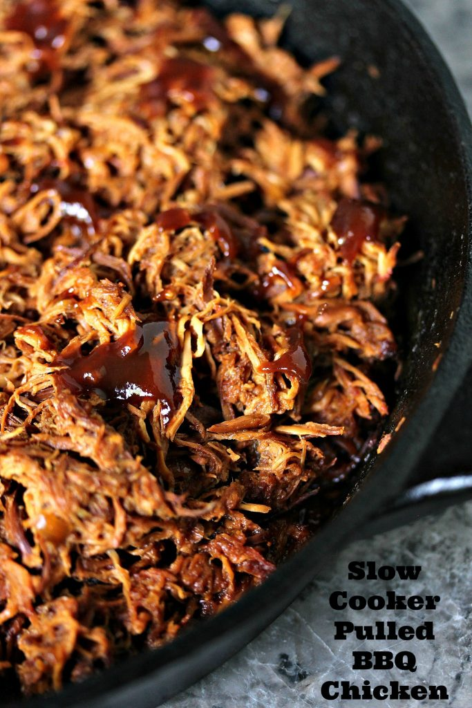Slow Cooker Pulled BBQ Chicken being warmed in a black cast iron pan.