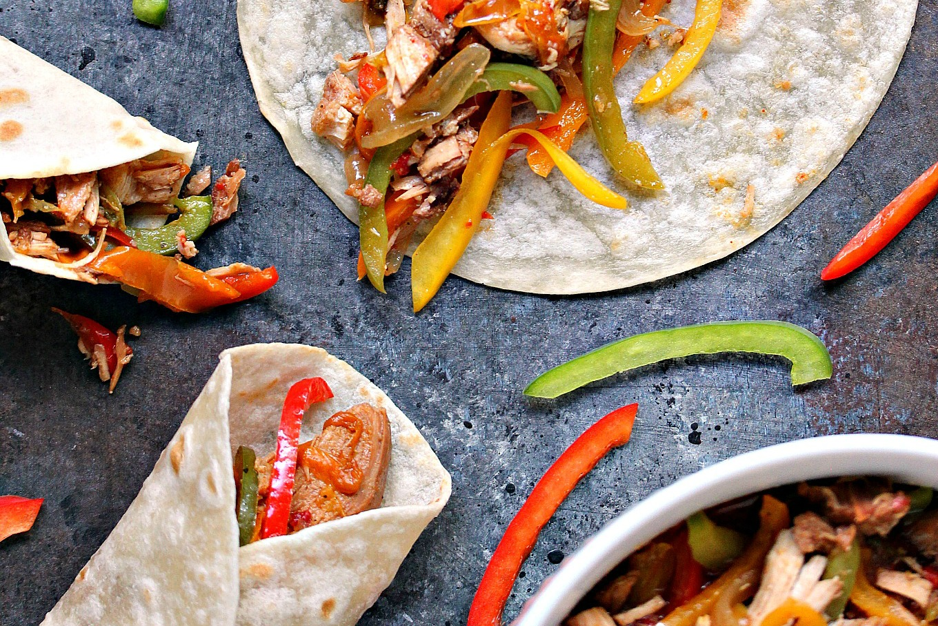 Slow Cooker Chicken Fajitas from cravingsofalunatic.com- This recipe is incredibly easy to make, but packed with intense flavour. Every bite is filled with bell peppers, onions and chicken, all wrapped up in a fabulous tortilla. (@CravingsLunatic)