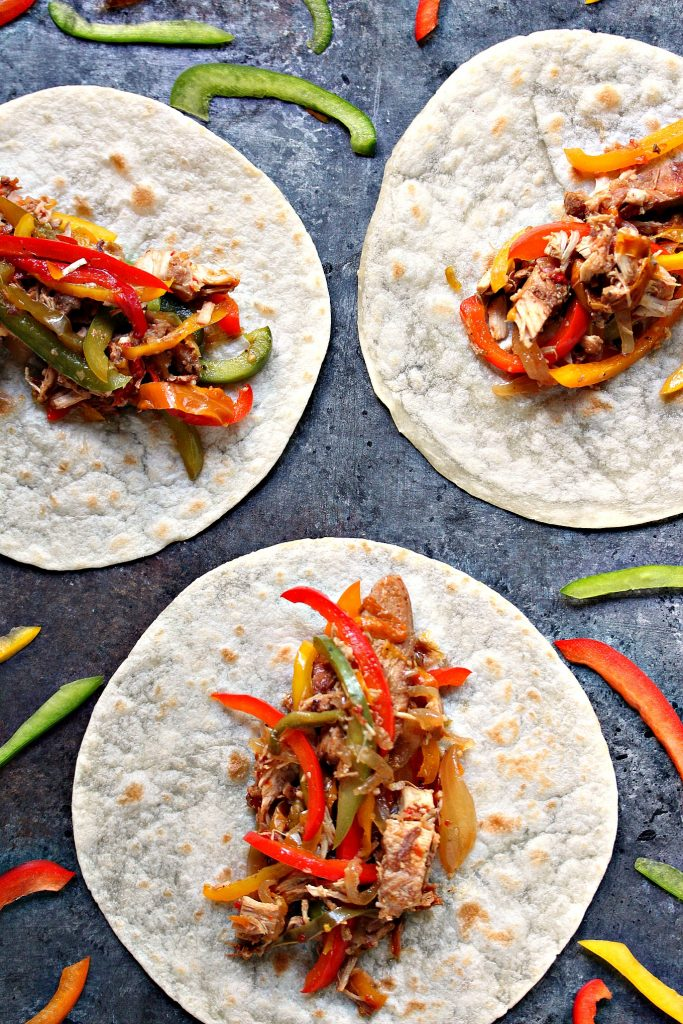 chicken fajitas open faced on a grey table