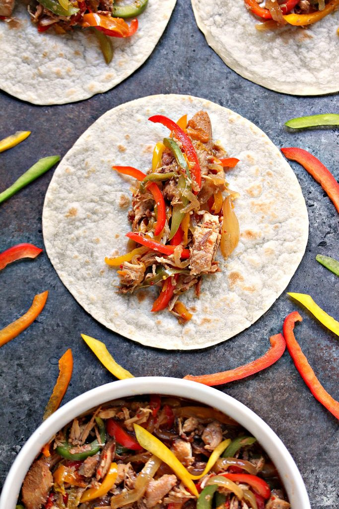 overhead image of slow cooker chicken fajitas