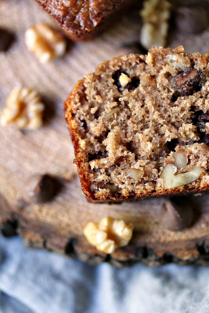close up overhead image of a slice of Peanut Butter Chocolate Banana Bread with Walnuts
