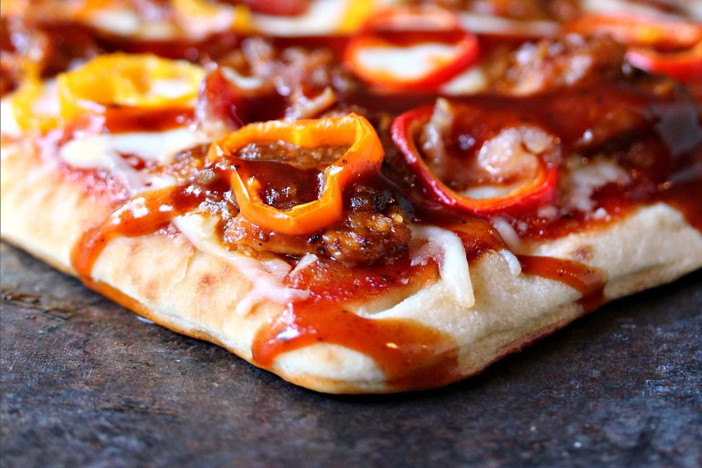 grilled flatbread pizza on a dark counter
