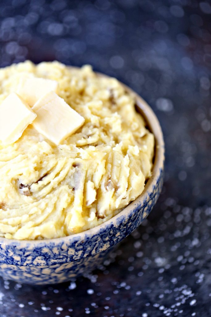 Slow Cooker Garlic Mashed Potatoes by cravingsofalunatic.com- This Slow Cooker Garlic Mashed Potatoes Recipe uses Yukon Gold potatoes, and fresh garlic. This method of preparing potatoes will change your whole life.