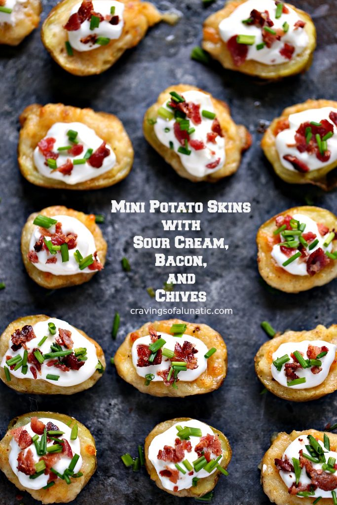 Mini Potato Skins with Sour Cream, Bacon, and Chives from cravingsofalunatic.com- This recipe for Mini Potato Skins with Sour Cream, Bacon, and Chives is simple and delicious. These little bites are perfect for entertaining, especially during game season.