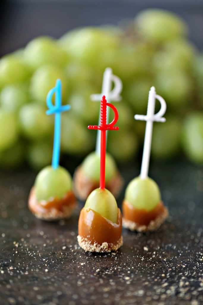 Caramel Dipped Grapes served with mini toothpick swords