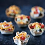 Mini Muffin Tin Taco Bites. Bite size taco cups made in mini muffin tins. These Mini Muffin Tin Taco Bites are perfect for the kids for lunch, dinner, or snacking. They also make great appetizers for parties.