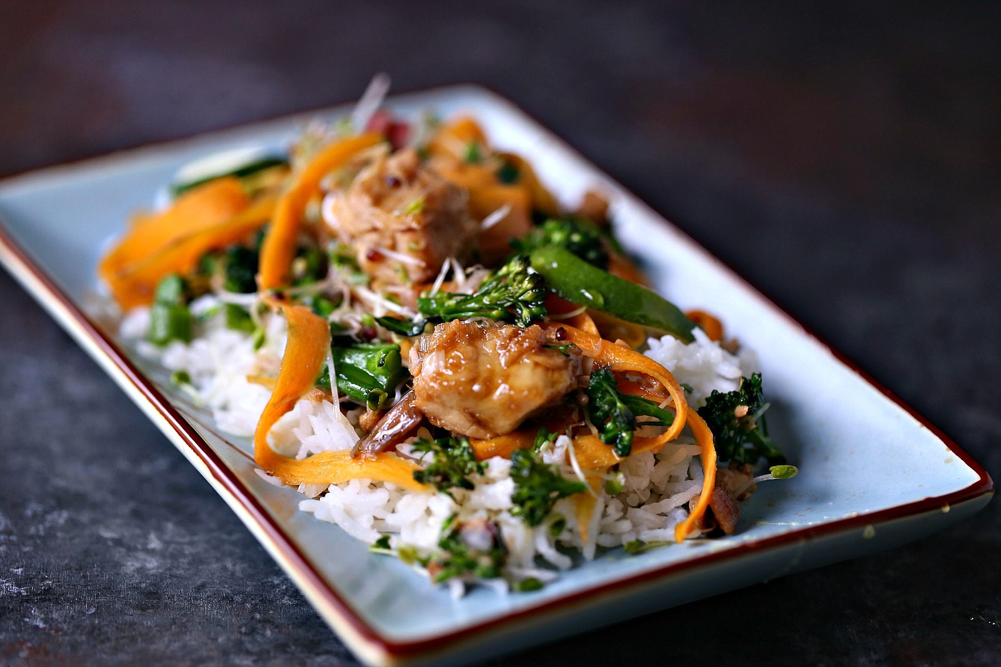 Easy Tuna Stir-Fry Bowls from cravingsofalunatic.com- This easy stir-fry recipe combines albacore tuna, broccolini, carrots, swiss chard, shallots, and broccoli sprouts. Finish with a squeeze of lime, and drizzle of honey.