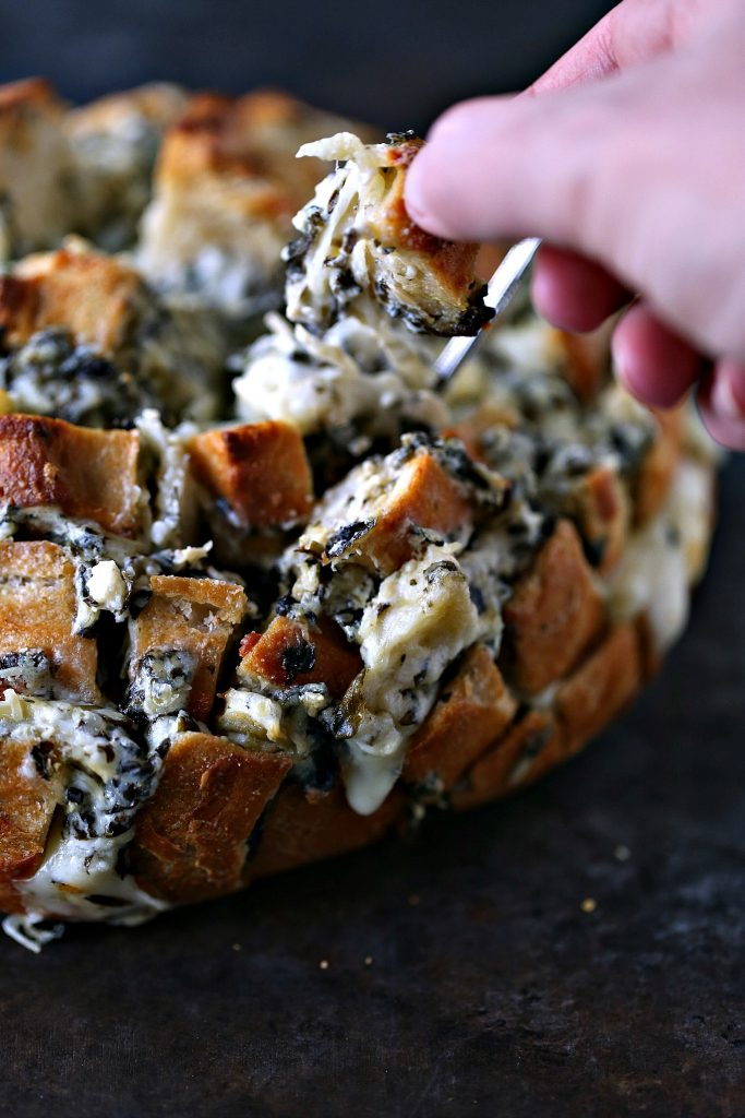 Spinach-Artichoke Cheesy Bread from cravingsofalunatic.com- This recipe is chock full of flavor yet remarkably easy to make. The bread is stuffed with spinach artichoke dip and cheese. You need to make this bread immediately.