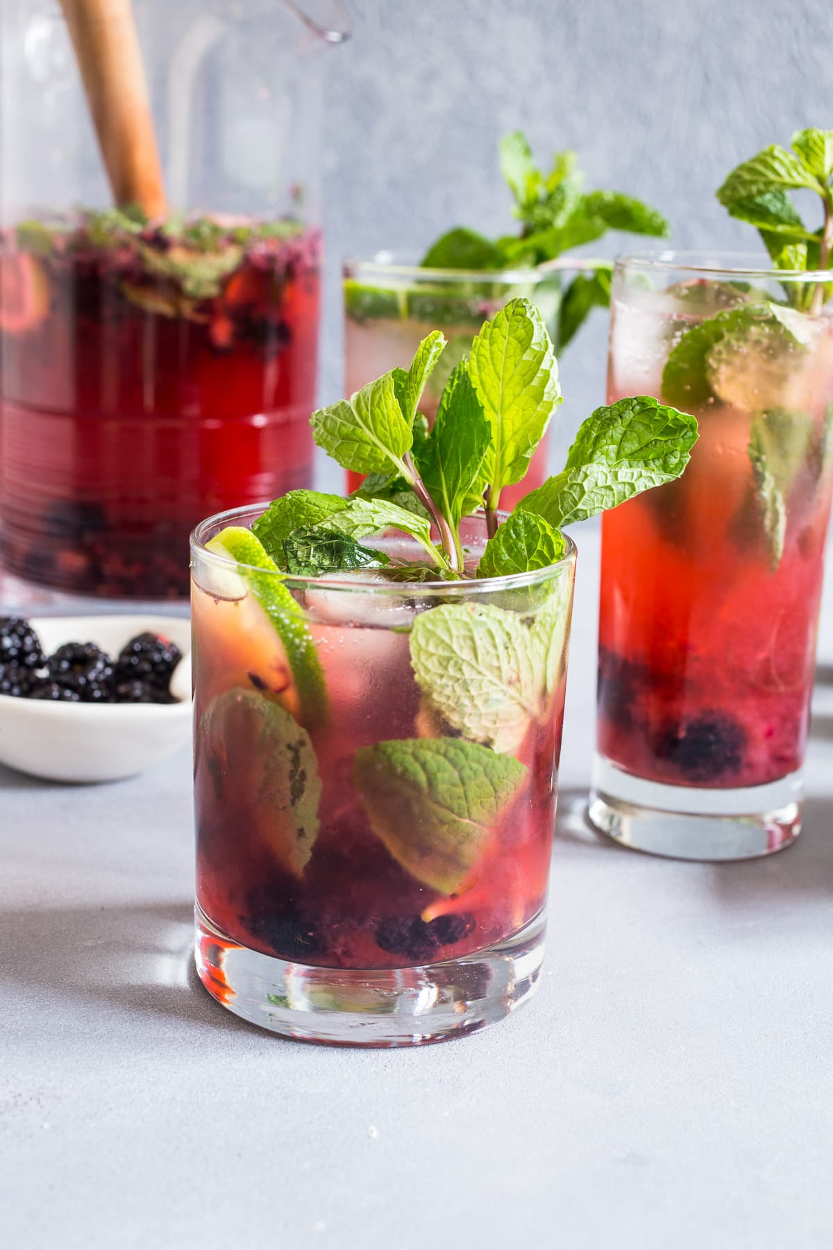 Blackberry Mojito Sangria from Girl in the Little Red Kitchen- featured on The Best Sangria Recipes by cravingsofalunatic.com- Celebrate summer in epic style with The Best Sangria Recipes! Sangria is so easy to make and super versatile. Whip up a batch today!