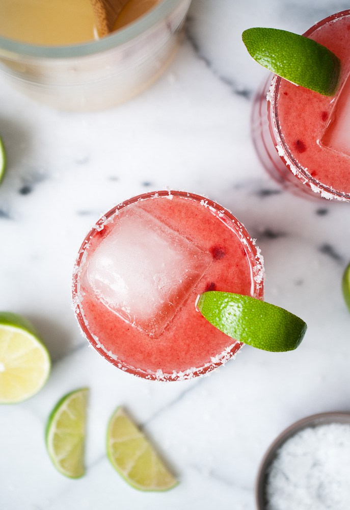 Cherry Margaritas from life is but a dish- featured on cravingsofalunatic.com. Kick off the summer season with The Best Margarita Recipes on the block. Sit back, relax, and sip one of these gorgeous margaritas. Or make them all so you can pick your favourite.