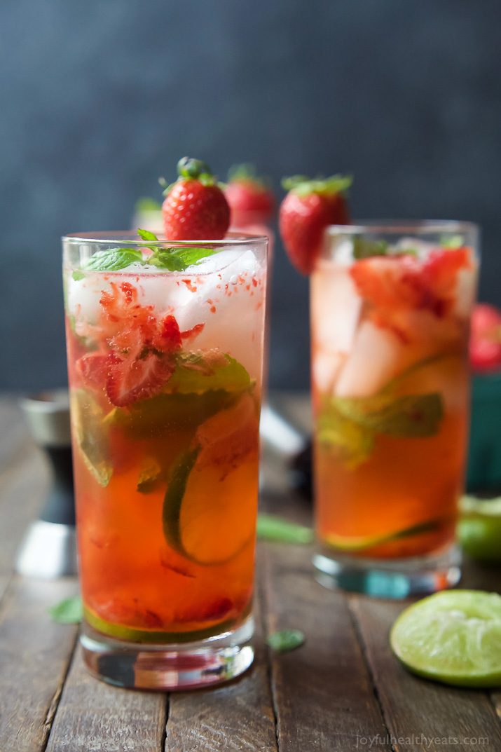 Fresh Strawberry Mojito from Joyful Healthy Eats featured on The Best Mojito Recipes on cravingsofalunatic.com- Kick off the summer season by making one of The Best Mojito Recipes on the web. These recipes are sure to be a hit with your family and friends.