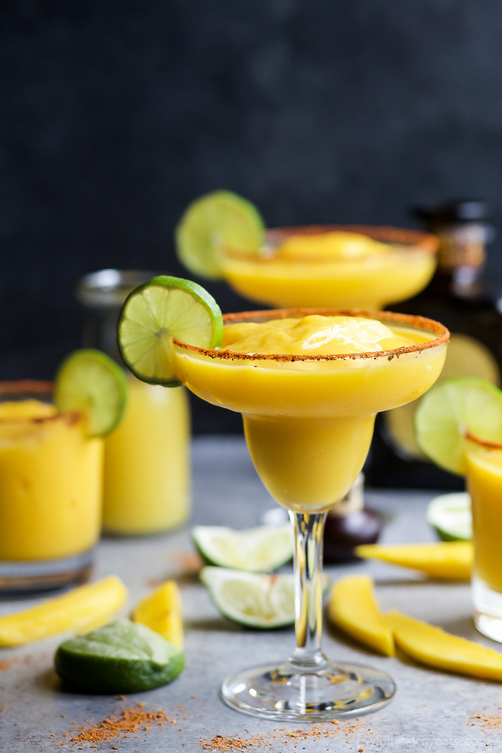 Frozen Mango Margaritas from Joyful Healthy Eats- featured on cravingsofalunatic.com. Kick off the summer season with The Best Margarita Recipes on the block. Sit back, relax, and sip one of these gorgeous margaritas. Or make them all so you can pick your favourite.