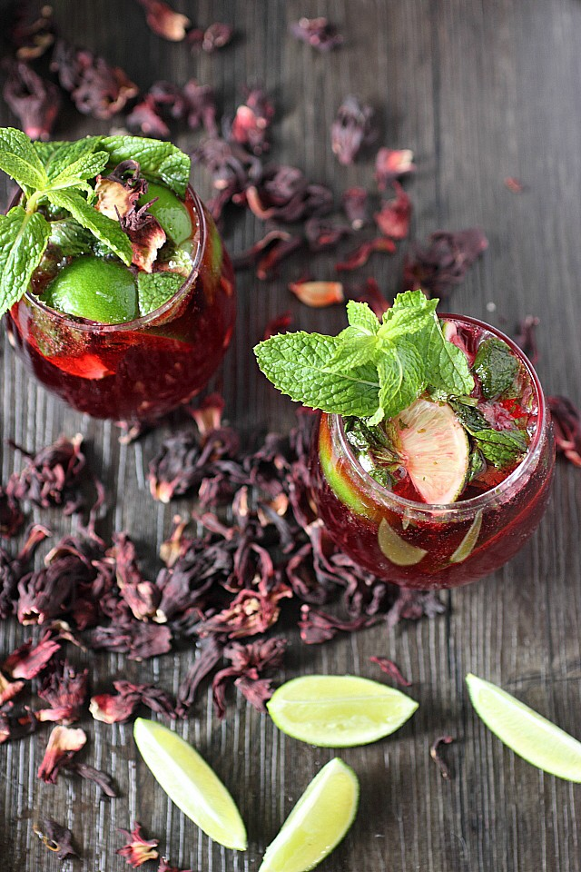 Hibiscus Mojito from Mind Over Batter featured on The Best Mojito Recipes on cravingsofalunatic.com- Kick off the summer season by making one of The Best Mojito Recipes on the web. These recipes are sure to be a hit with your family and friends.