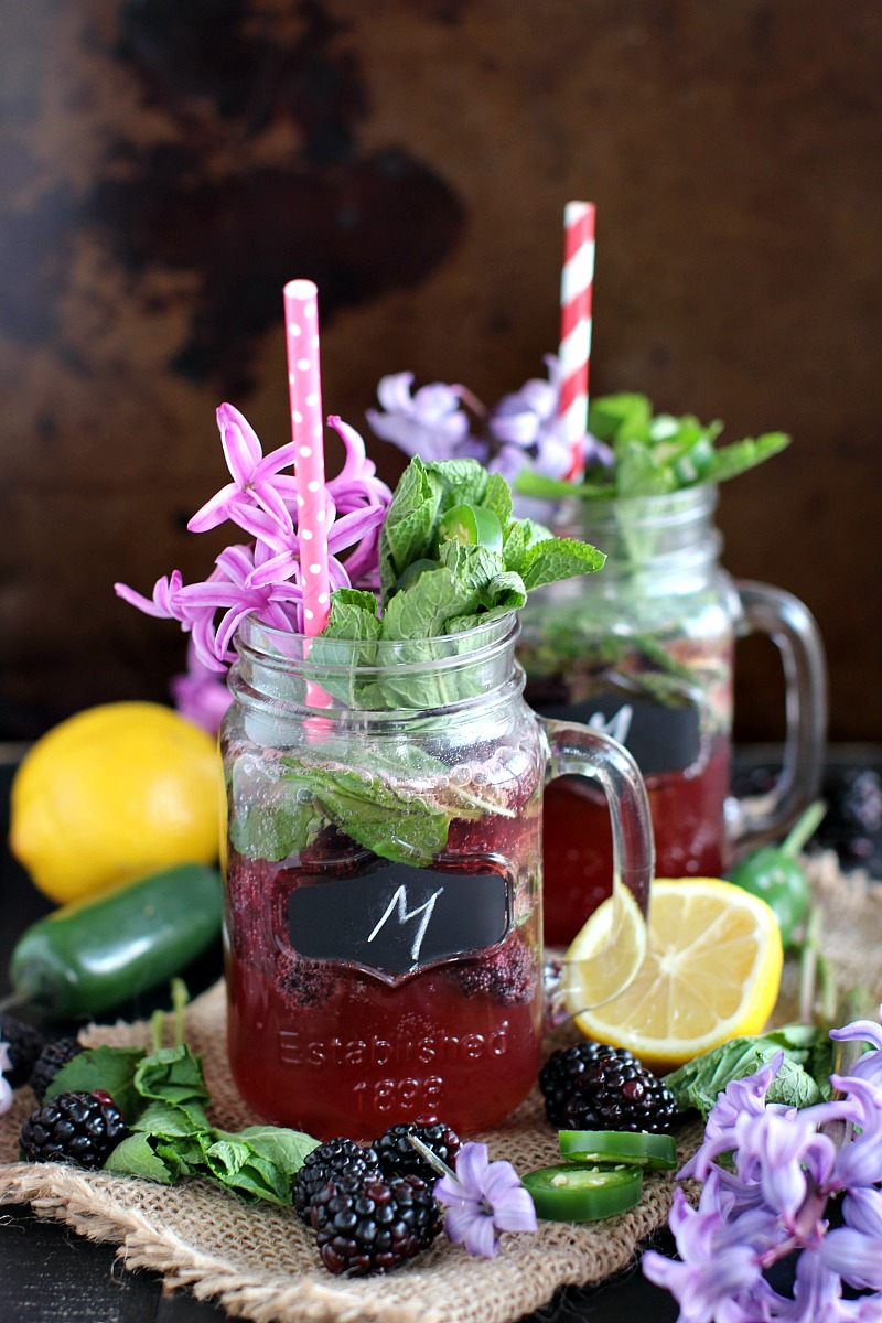 Lemon Jalapeno Blackberry Mojito from Peas and Peonies featured on The Best Mojito Recipes on cravingsofalunatic.com- Kick off the summer season by making one of The Best Mojito Recipes on the web. These recipes are sure to be a hit with your family and friends.