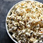 Enjoy a late afternoon treat with this Parmesan Popcorn recipe. Air-popped popcorn topped with parmesan cheese and dried parsley. Perfect for an afternoon treat!