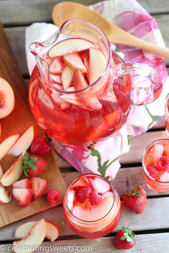 Peach Rosé Sangria from Julie's Eats and Treats- featured on The Best Sangria Recipes by cravingsofalunatic.com- Celebrate summer in epic style with The Best Sangria Recipes! Sangria is so easy to make and super versatile. Whip up a batch today!