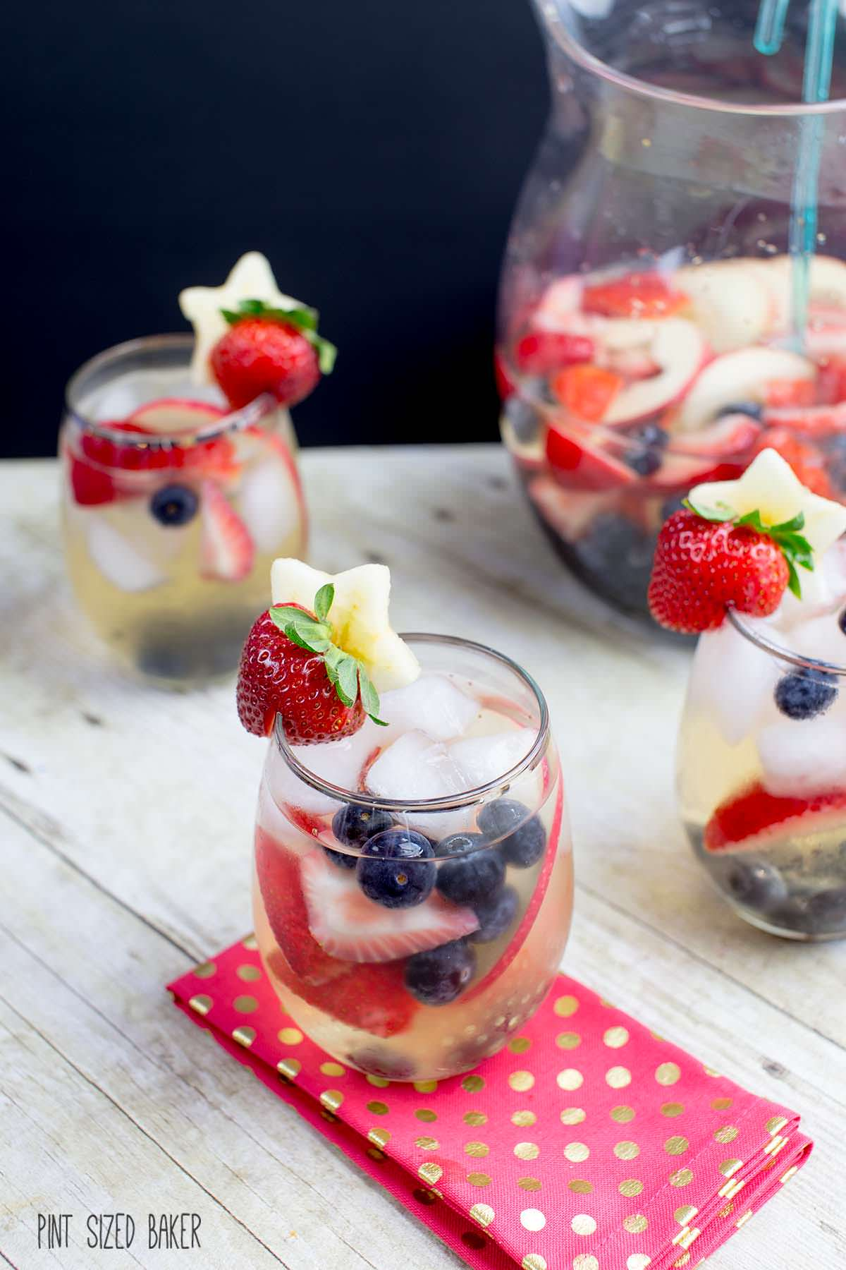 Red, White, and Blue Sangria from Pint Sized Baker- featured on The Best Sangria Recipes by cravingsofalunatic.com- Celebrate summer in epic style with The Best Sangria Recipes! Sangria is so easy to make and super versatile. Whip up a batch today!