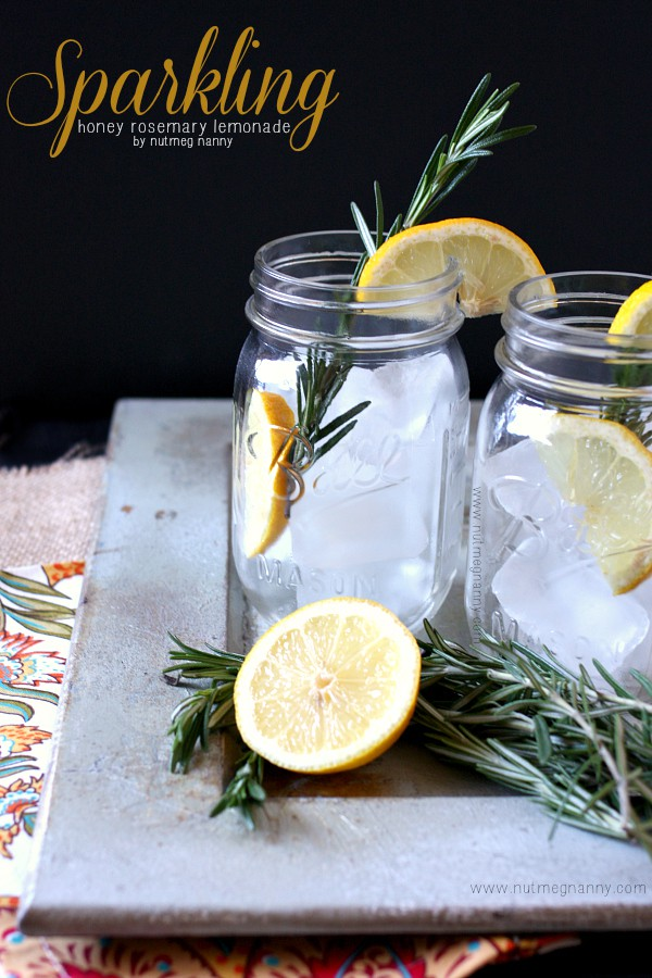 Sparkling Honey Rosemary Lemonade from Nutmeg Nanny- featured on The Best Lemonade Recipes by cravingsofalunatic.com- Spend your summer sipping all The Best Lemonade Recipes you can get your hands on. Summer is all about refreshing beverages so make the most of it!